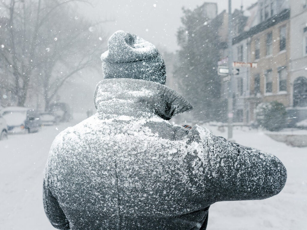 man dusted in snow