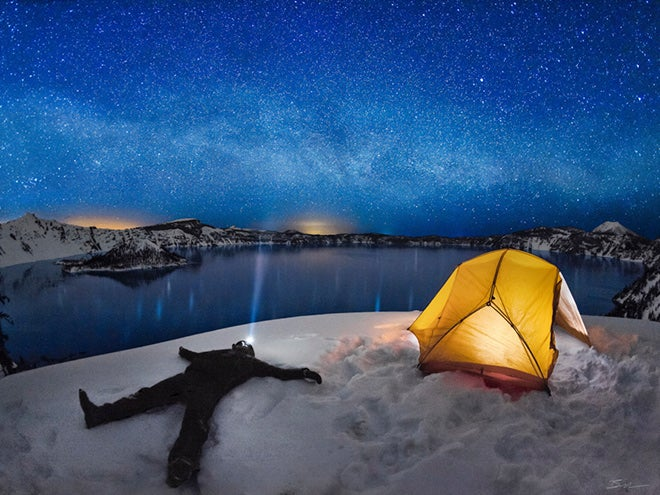 Intense starlight and brightly lit tent