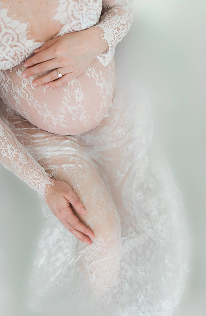 pregnant woman and lace in a milk bath