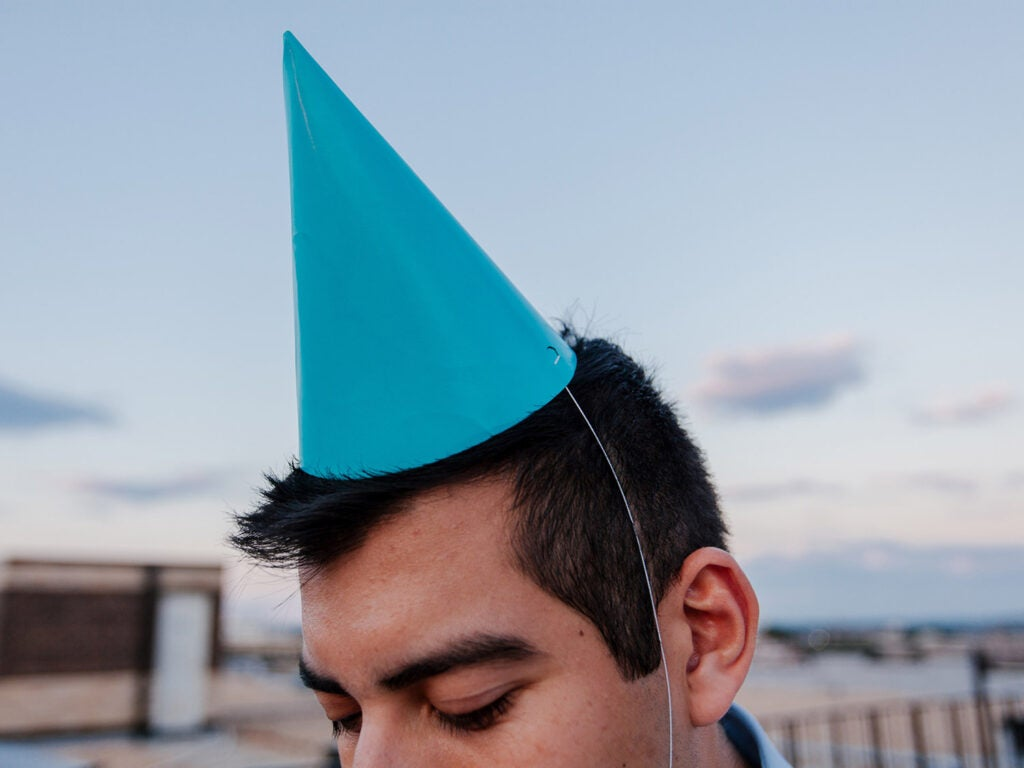 man with a blue party hat