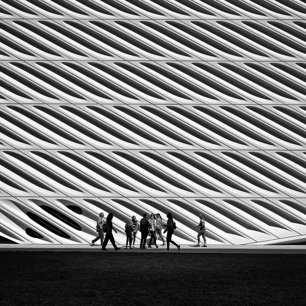 people walking by the Broad Building