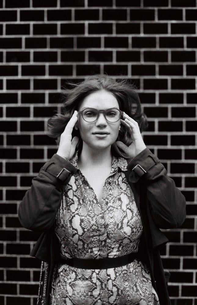 black and white photo of model with glasses