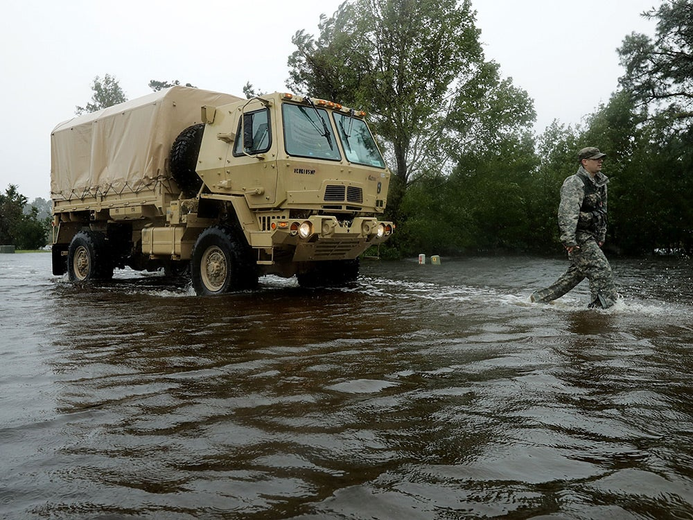 National Guard 105th Military Police Battalion from Asheville search for evacuees