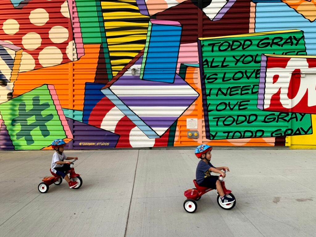 Kids on trikes shot with iPhone XS Max