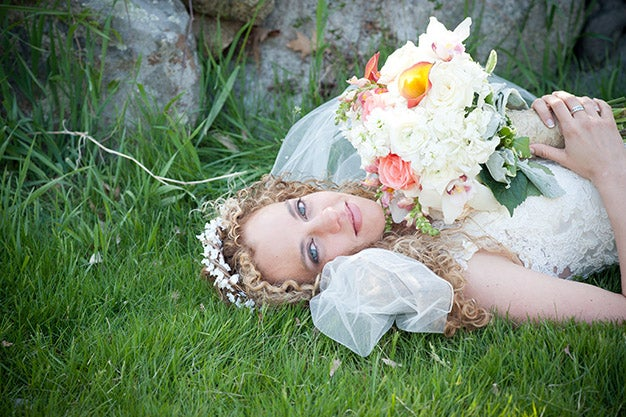 bride posing in the grass