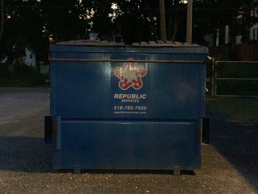 A picture of a dumpster with flash on