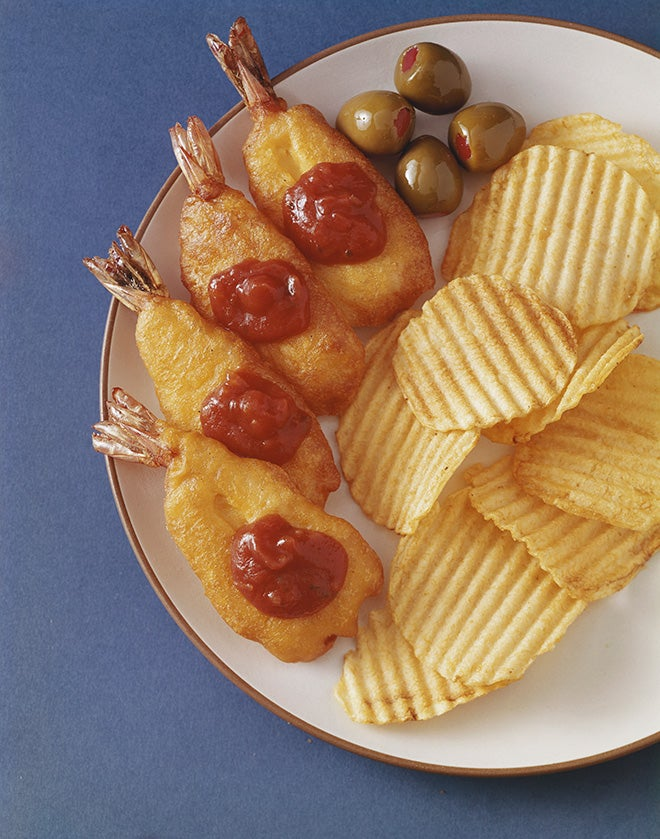Deep fried battered prawns with tomato sauce, green olives and chips