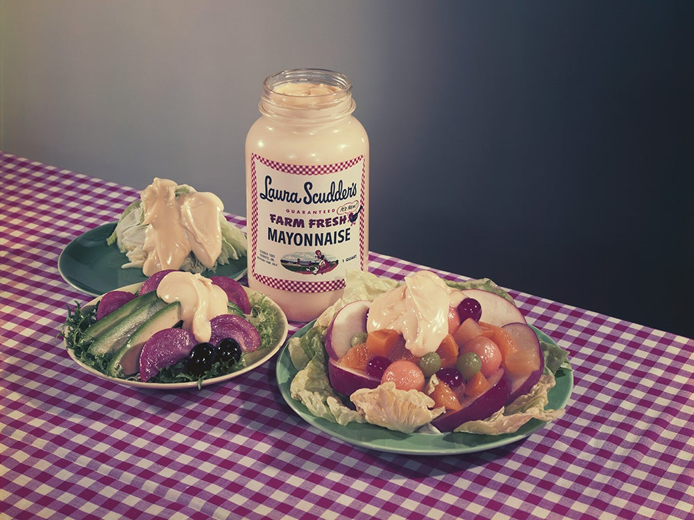 Salad topped with mayonnaise with mayonnaise bottle