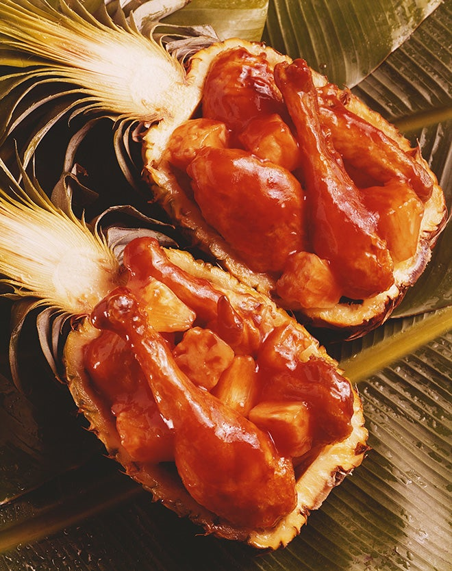 Chicken leg and meat stuffed in pineapple