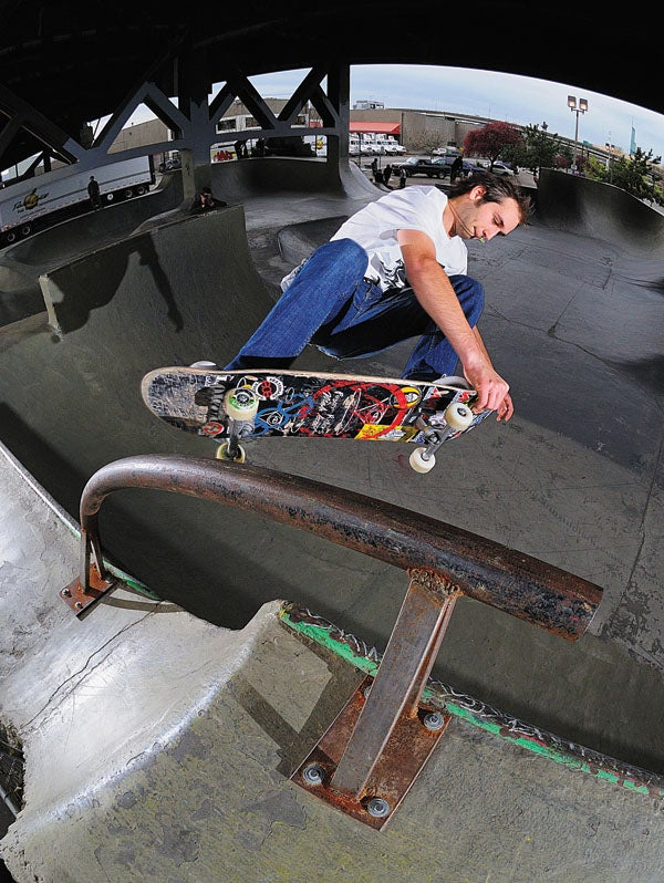 Rocco performing on a new bar prop in the park on skateboard