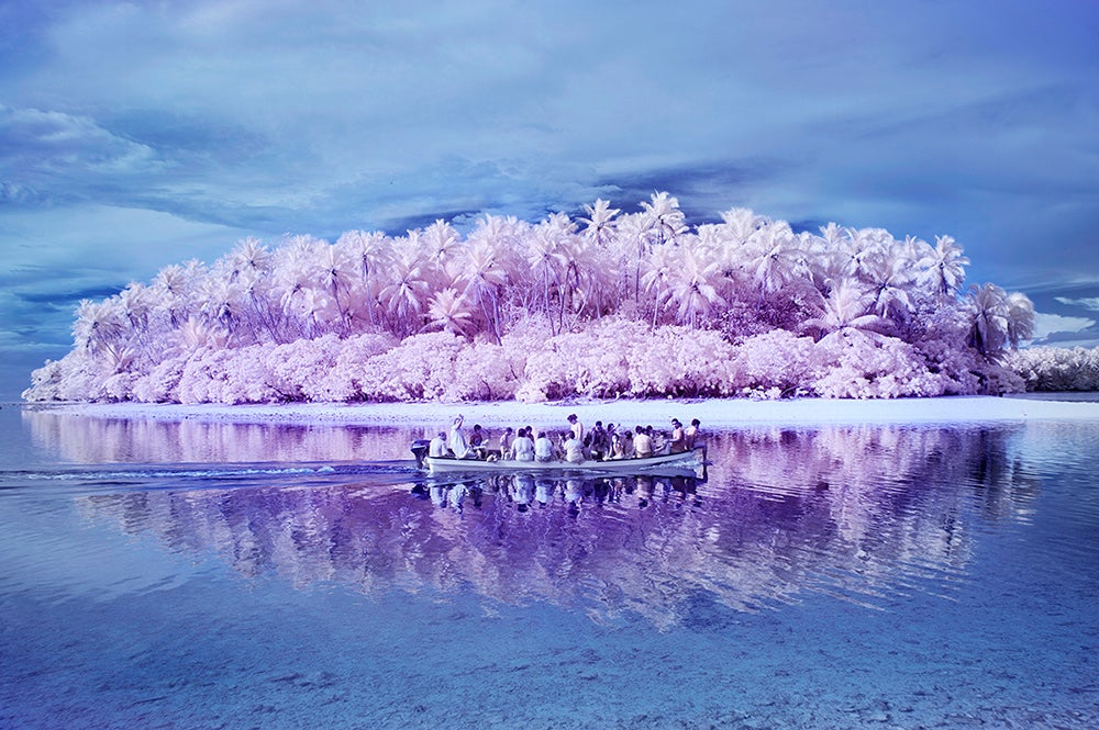 boat full of people on winter water
