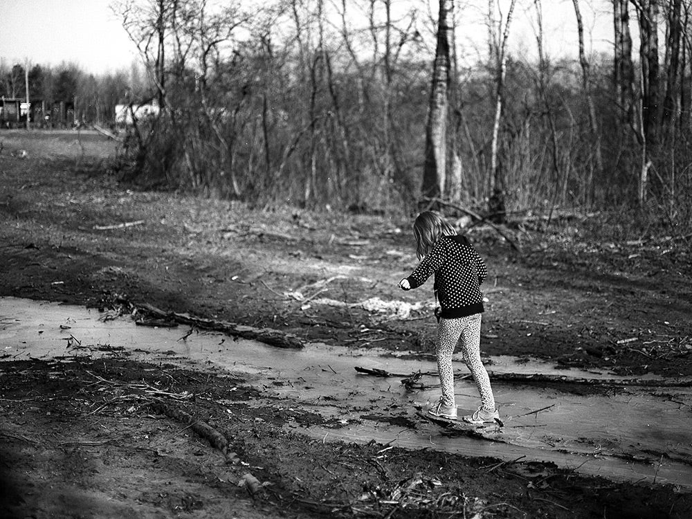 black and white photo of person walking