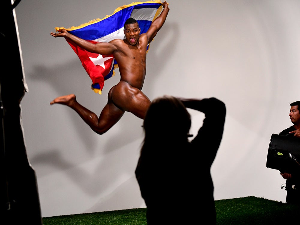naked athlete jumping with country's flag