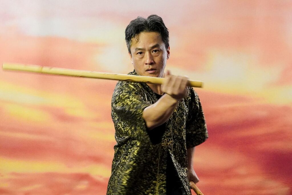 Martial artist with stick