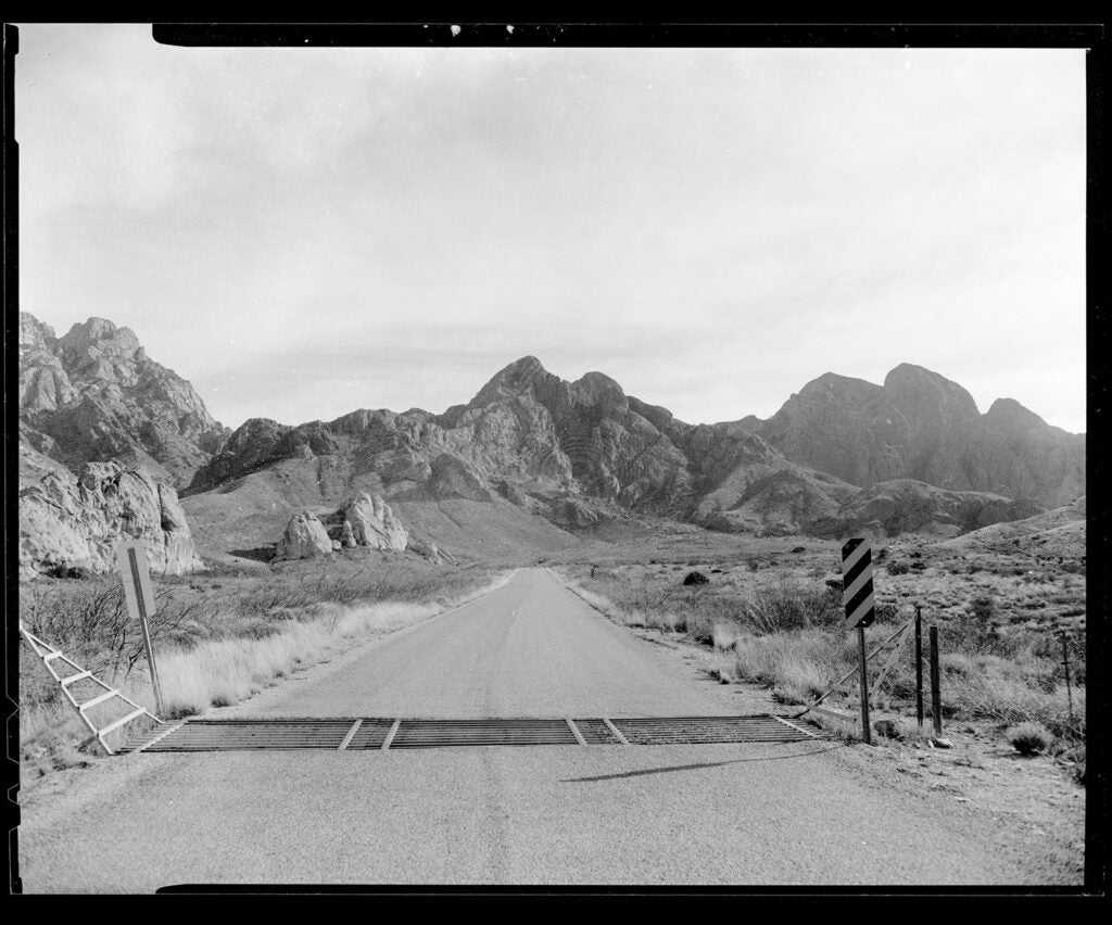 black and white road scenery