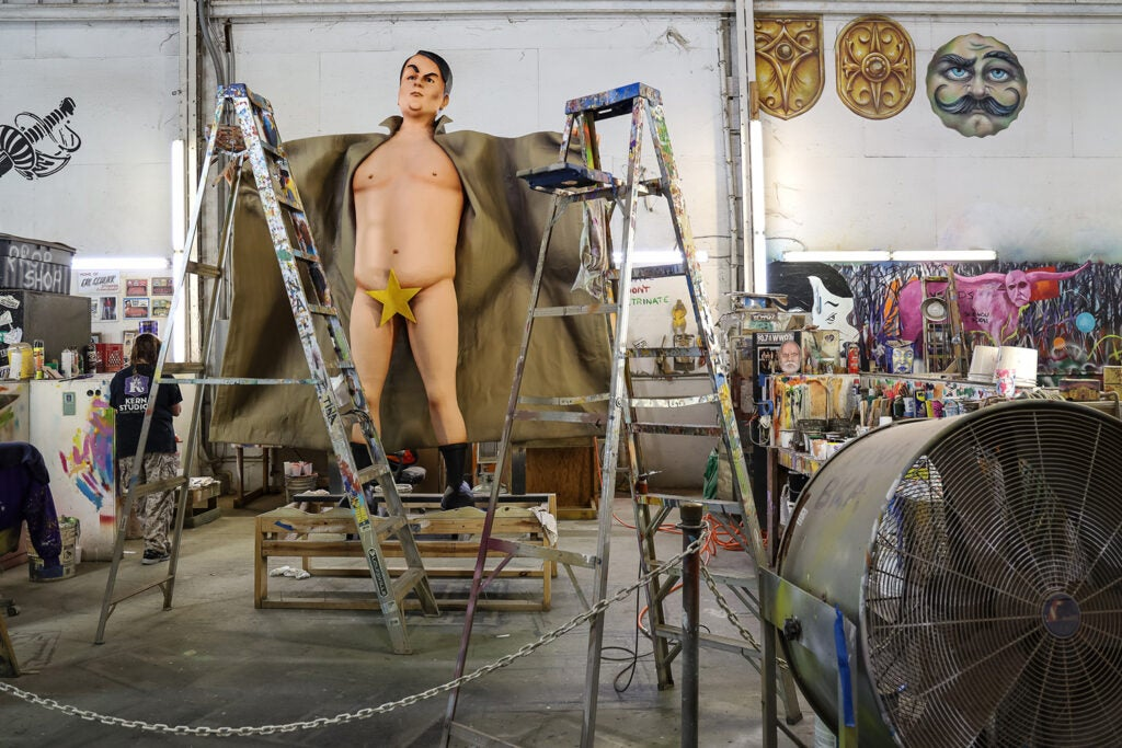 naked mannequin covered with star