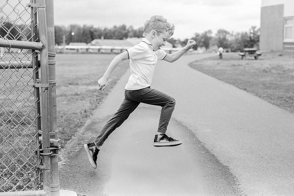 ian jumping in black and white