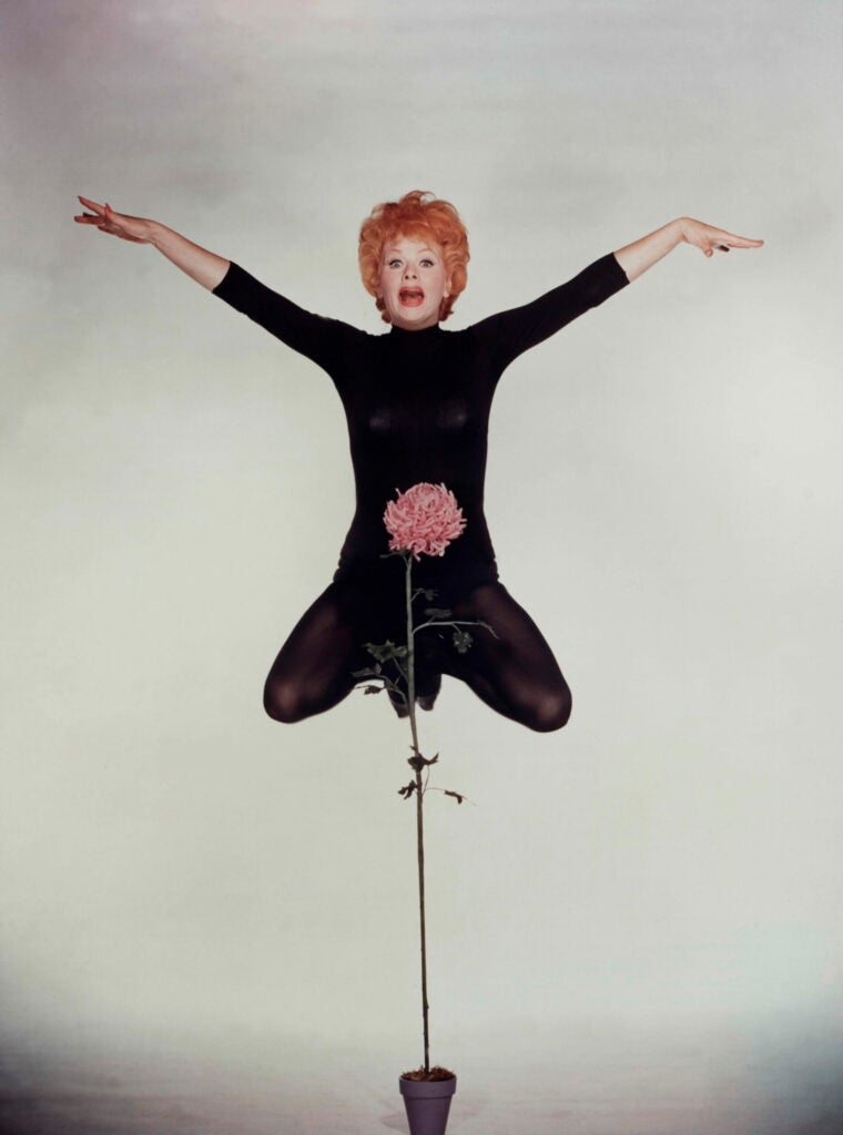 lucille ball jumping with flower