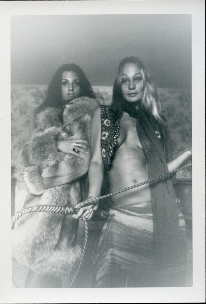 women in fur holding rope