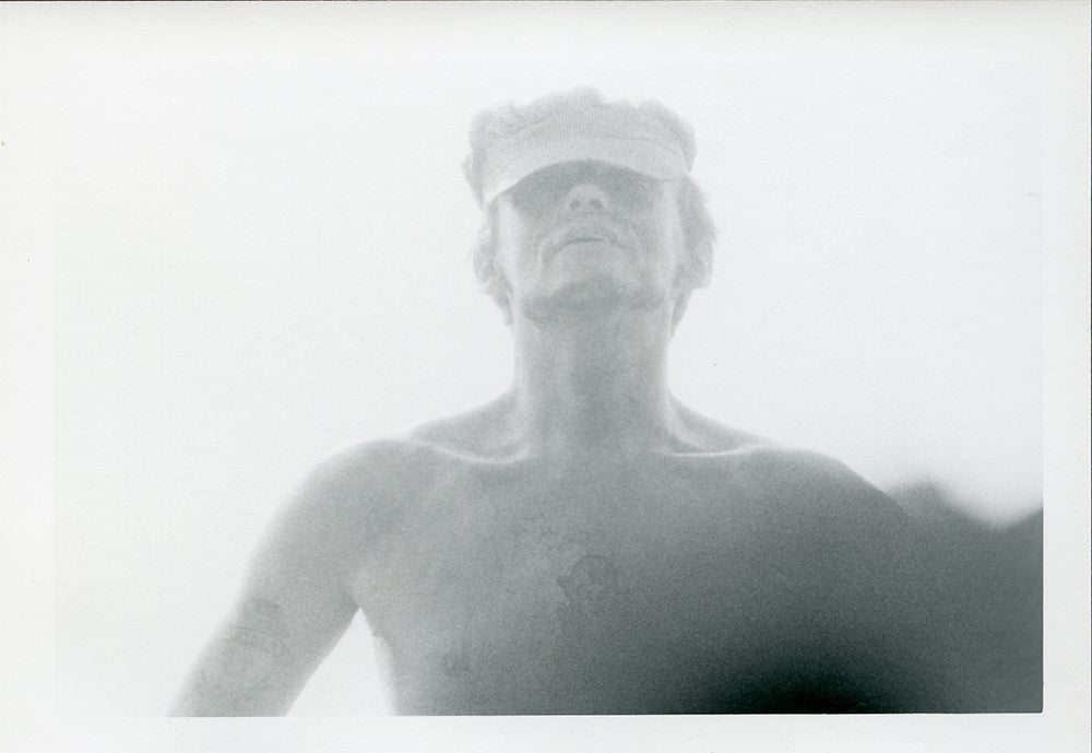 man with hat no shirt