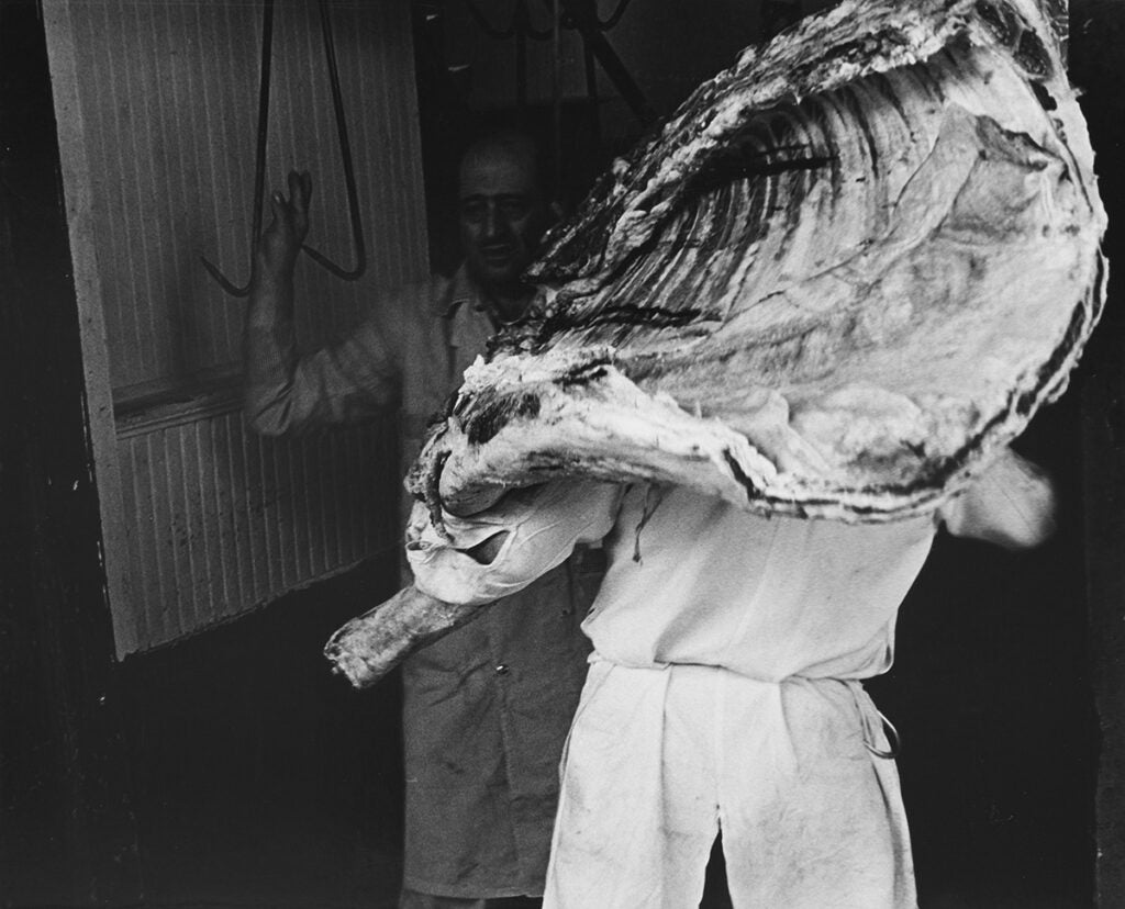 Untitled [Tom Roddy carrying a carcass of beef], 1968-70. From the series
