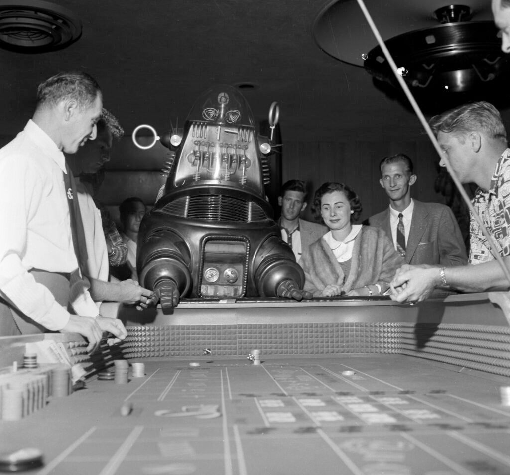 httpswww.popphoto.comsitespopphoto.comfilesimages201507007_robbie_the_robot_shooting_craps_at_the_sands_may_20_1956.jpg