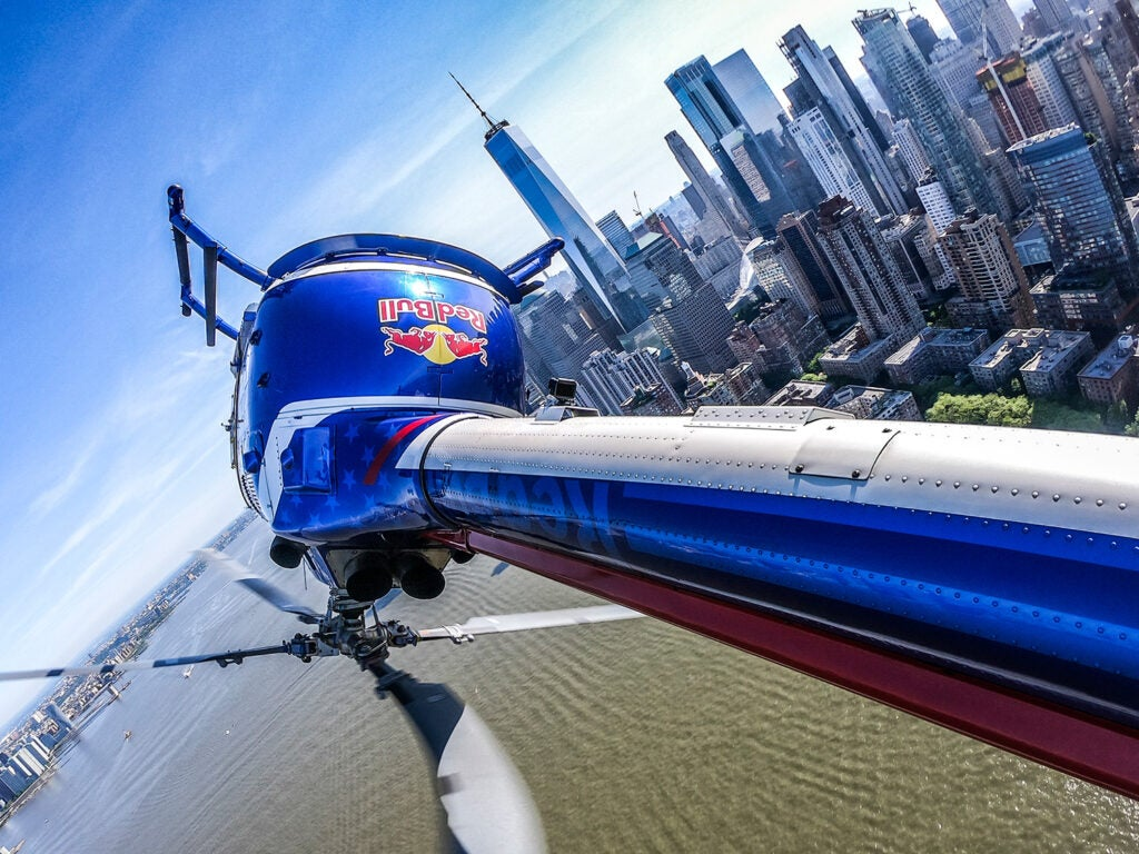 POV shot of red bull helicopter in the midst of one of its aerial maneuvers