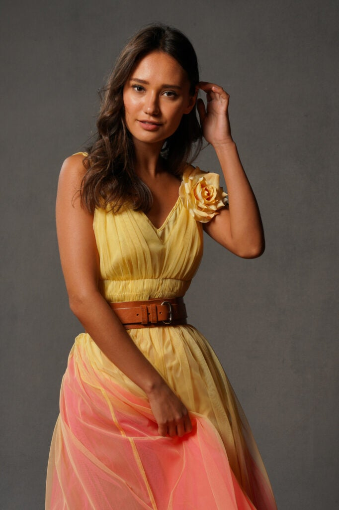 woman in yellow and pink dress