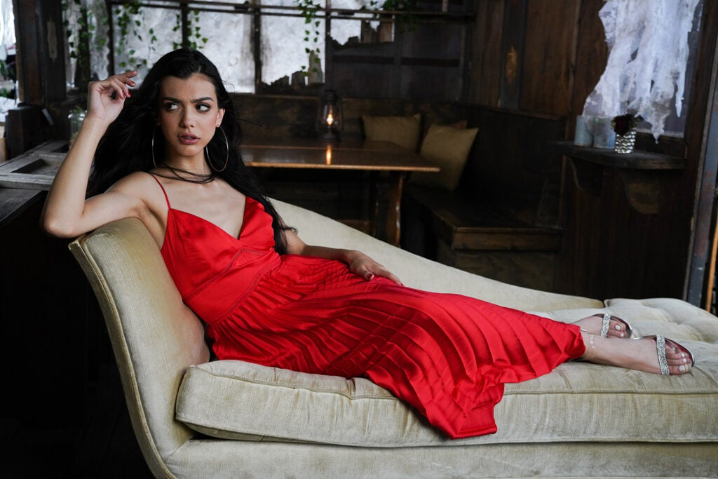 woman in red dress lounging