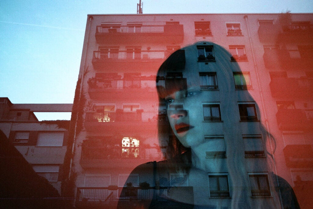 blue reflection of girl and red building
