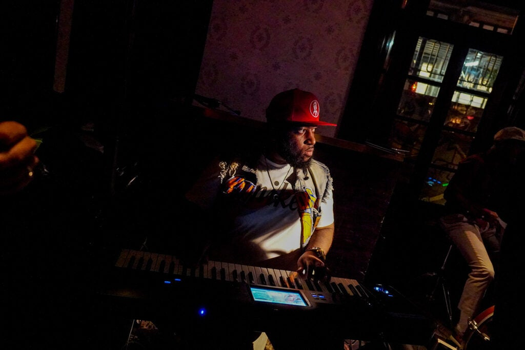 playing the keyboard in a red hat