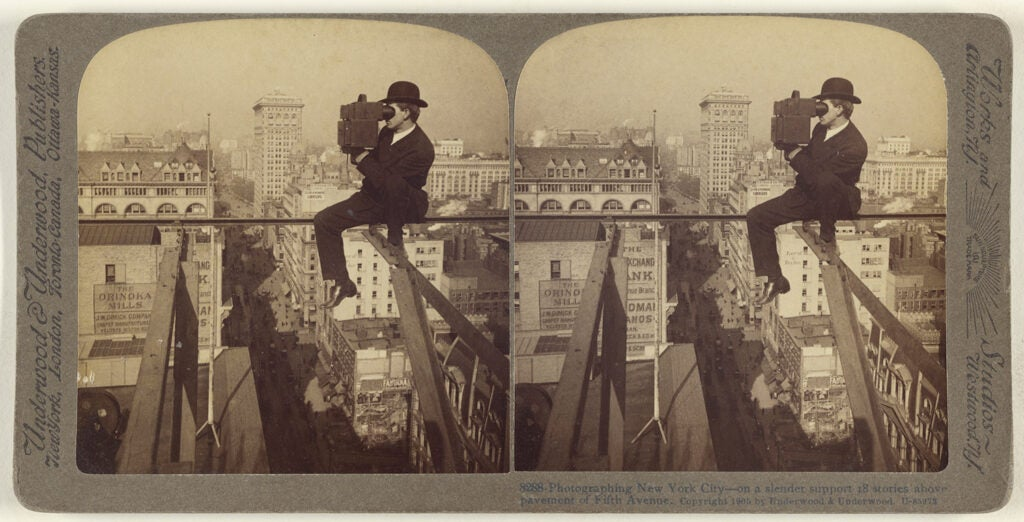 Photographing New York City - on a slender support 18 stories above pavement of Fifth Avenue