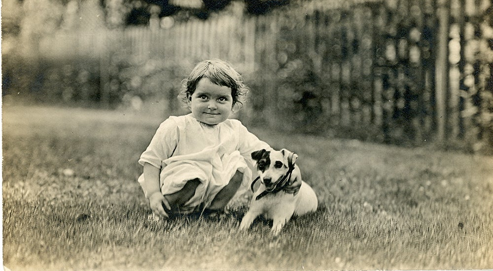 Vintage photo of small girl and her puppy
