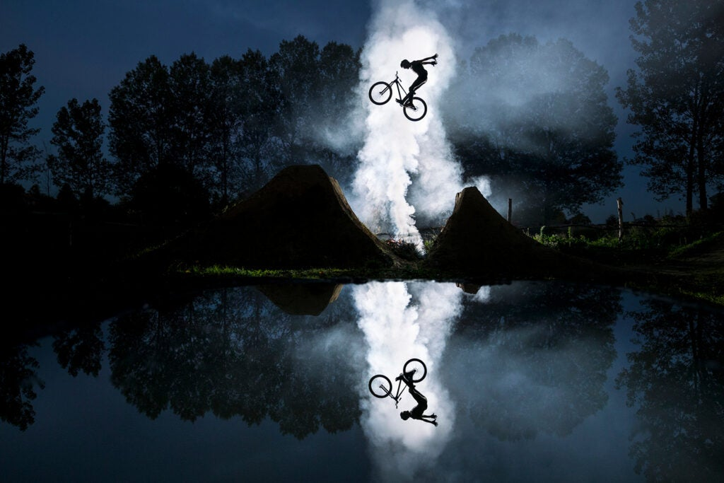 mirrored shot of Jeremy Berthier jumping on bicycle