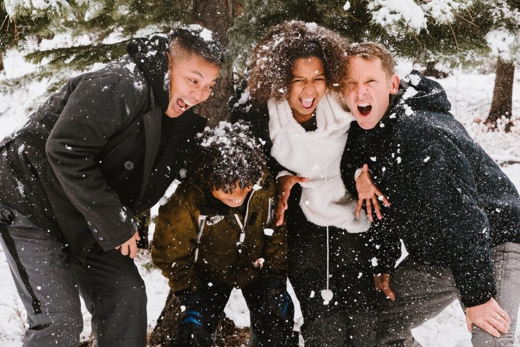 People laughing in the snow