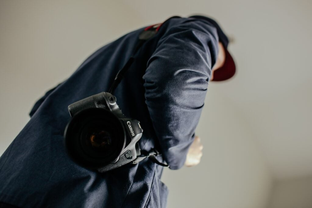 Person carrying camera over the shoulder