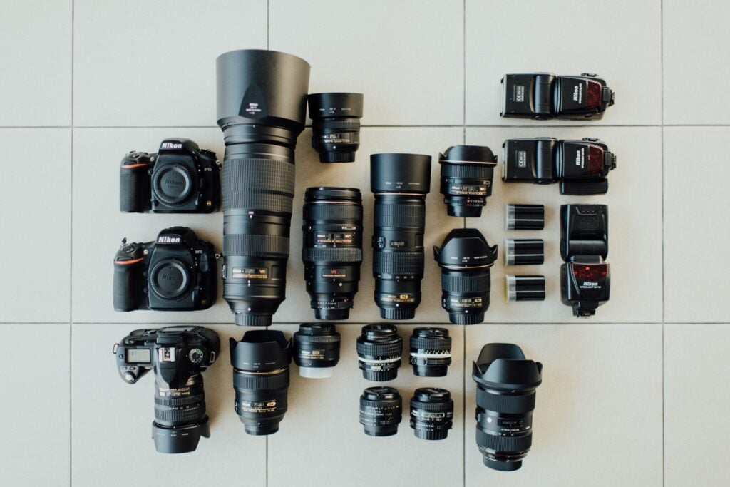Cameras and photolenses spread on the floor