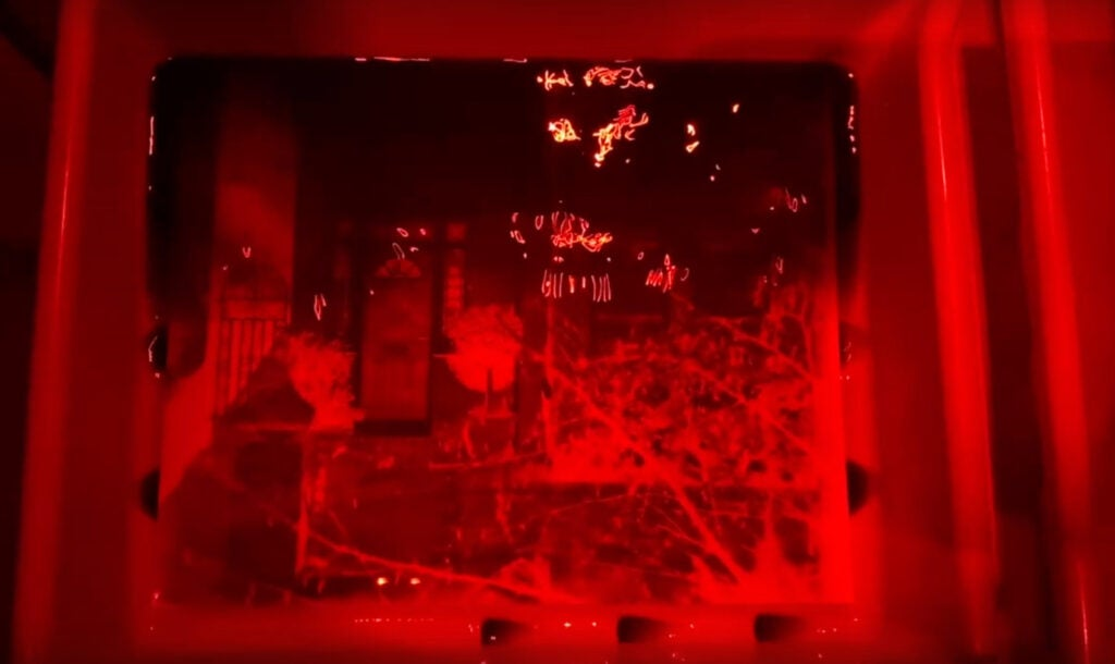 Brendan Barry develops a print from his camera obscura using his homemade chemicals