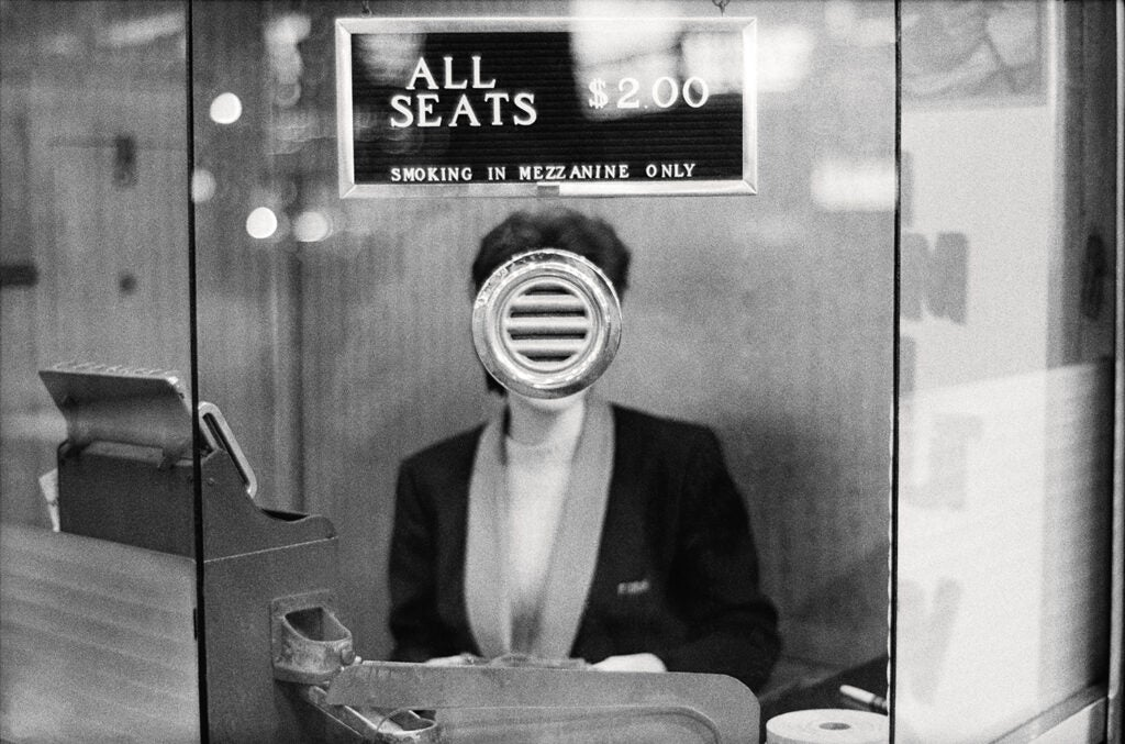 woman selling tickets to show