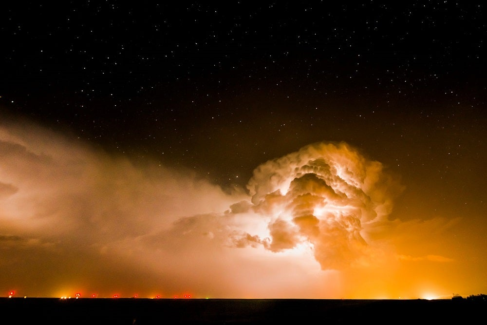 A lightning-filled cloud looms over the city lights of Burlington, Colorado. May 20, 2014.