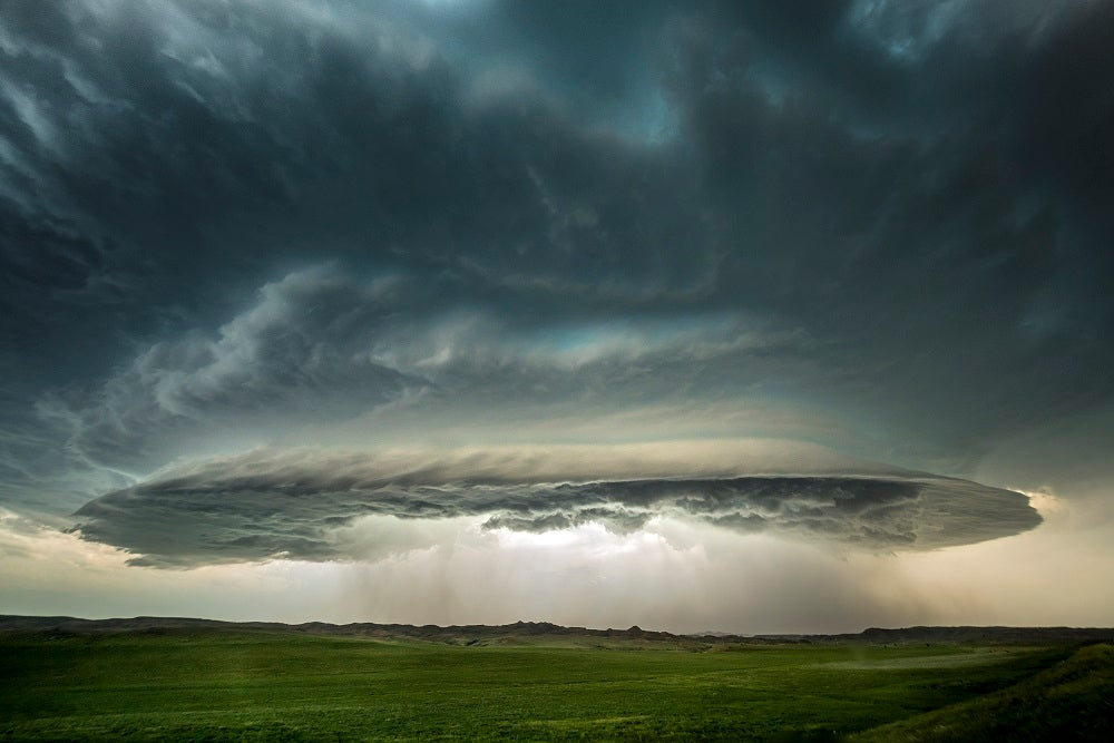 A supercell with sides sculpted by updraft winds hovers over Circle, Montana. June 9, 2016.